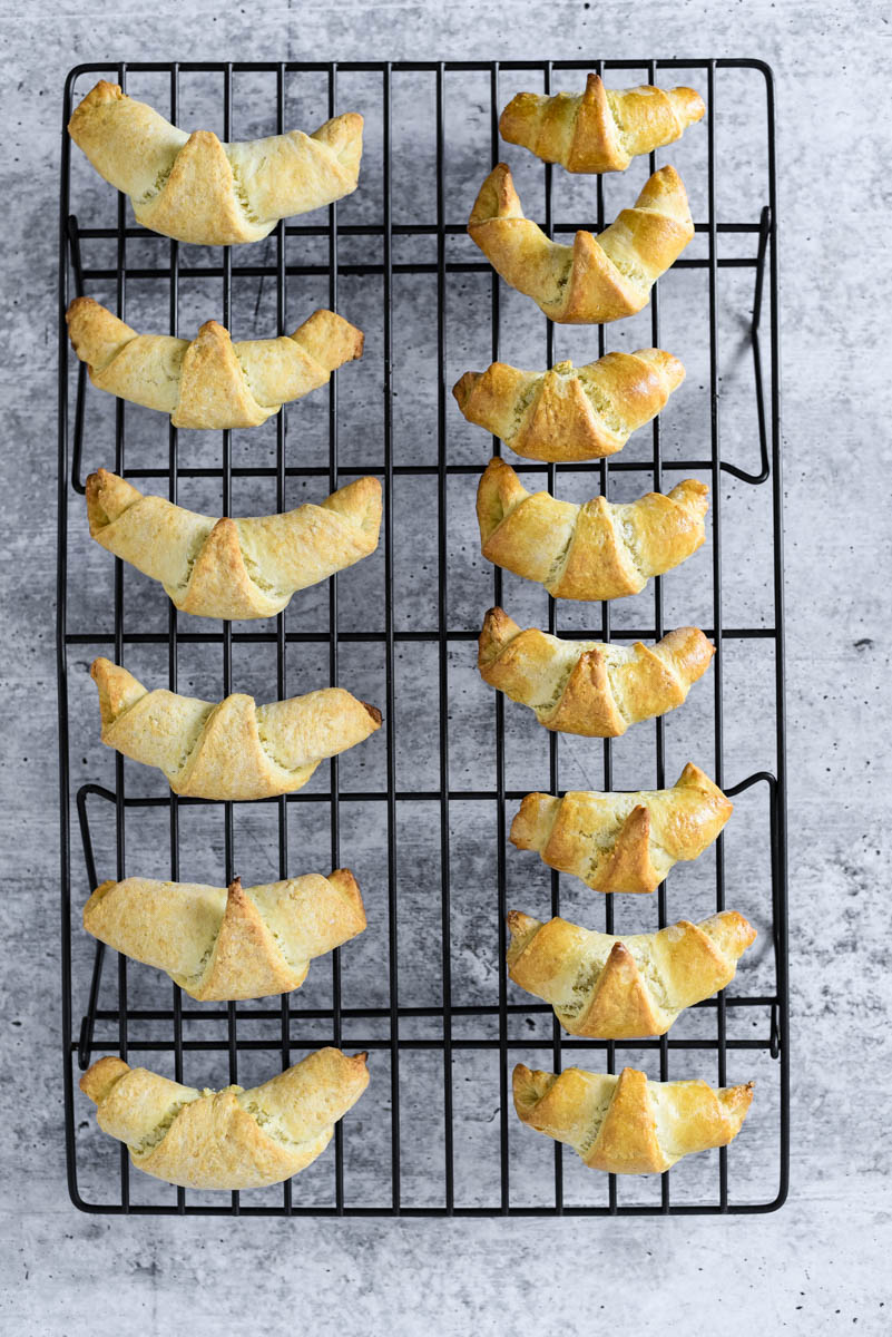 cooling rack lined with freshly baked sourdough crescent rolls