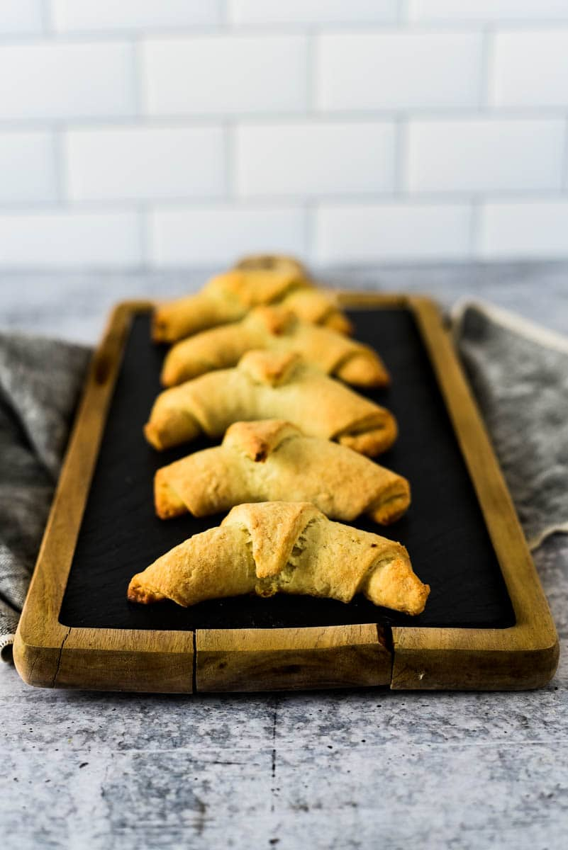 sourdough crescent rolls lined up on cutting board