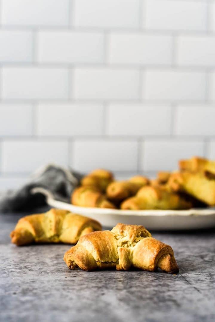 sourdough crescent rolls in front of white serving platter