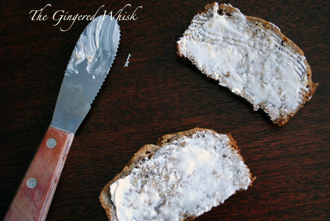 Earl Grey Banana Bread slices with butter spread beside butter knife