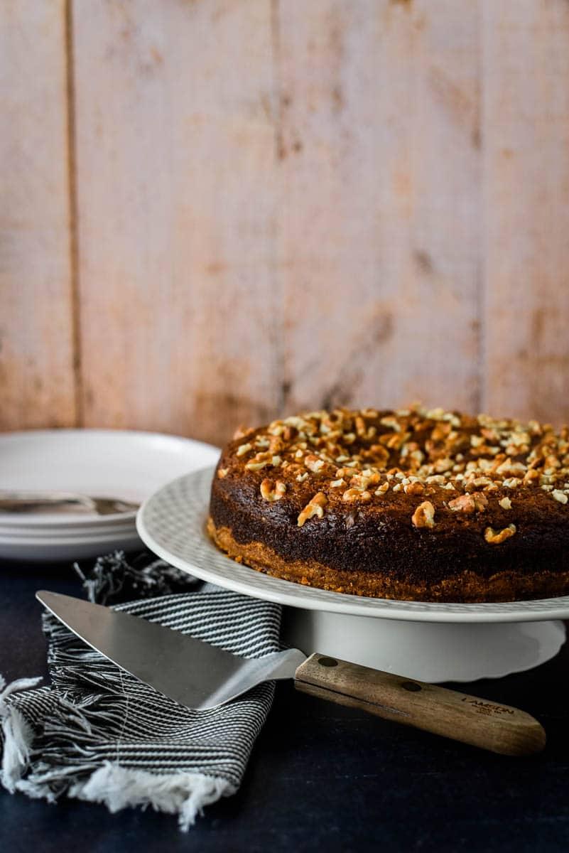 armenian nutmeg cake on white cake stand