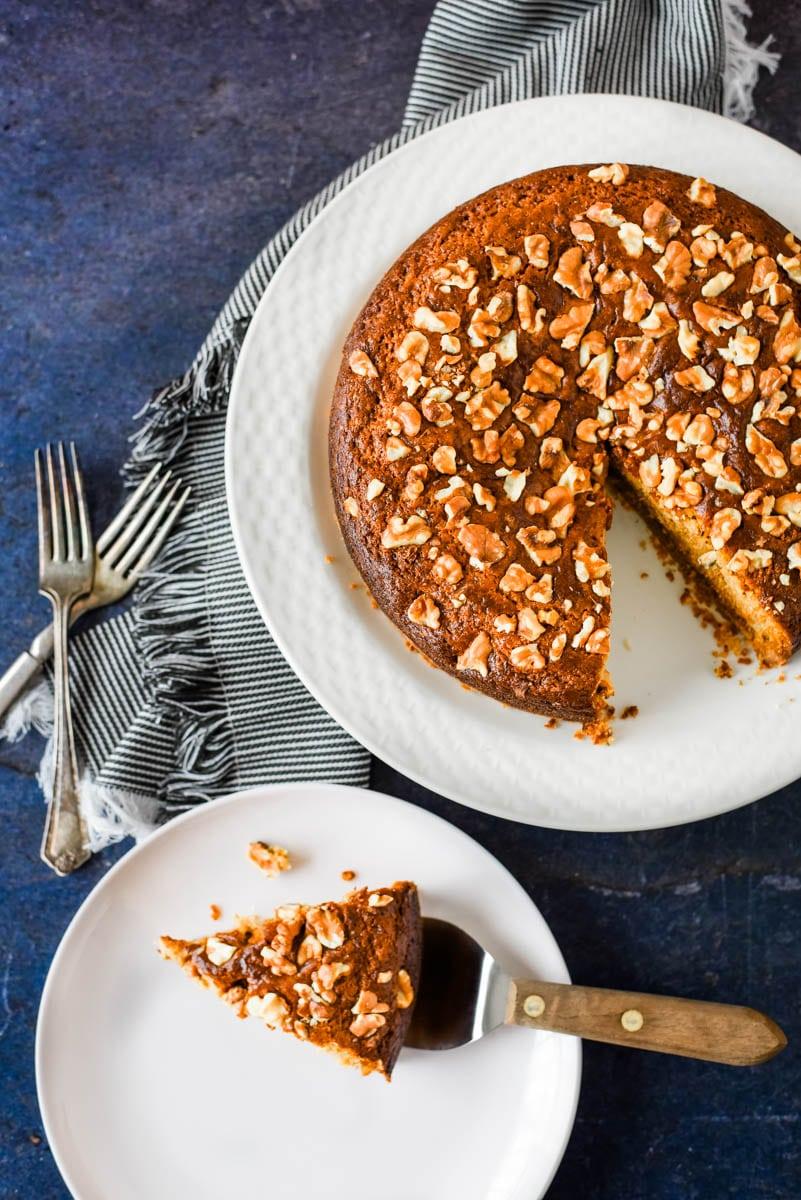 slice of armenian nutmeg cake beside cake plate