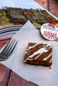 butterbeer bar on napkin beside fork and book