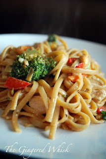 chicken pad thai on plate with red peppers and broccoli