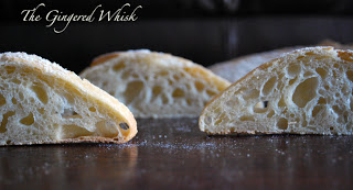 slices of ciabatta bread standing on a table