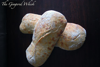 two loaves of sourdough ciabatta bread on top of each other.