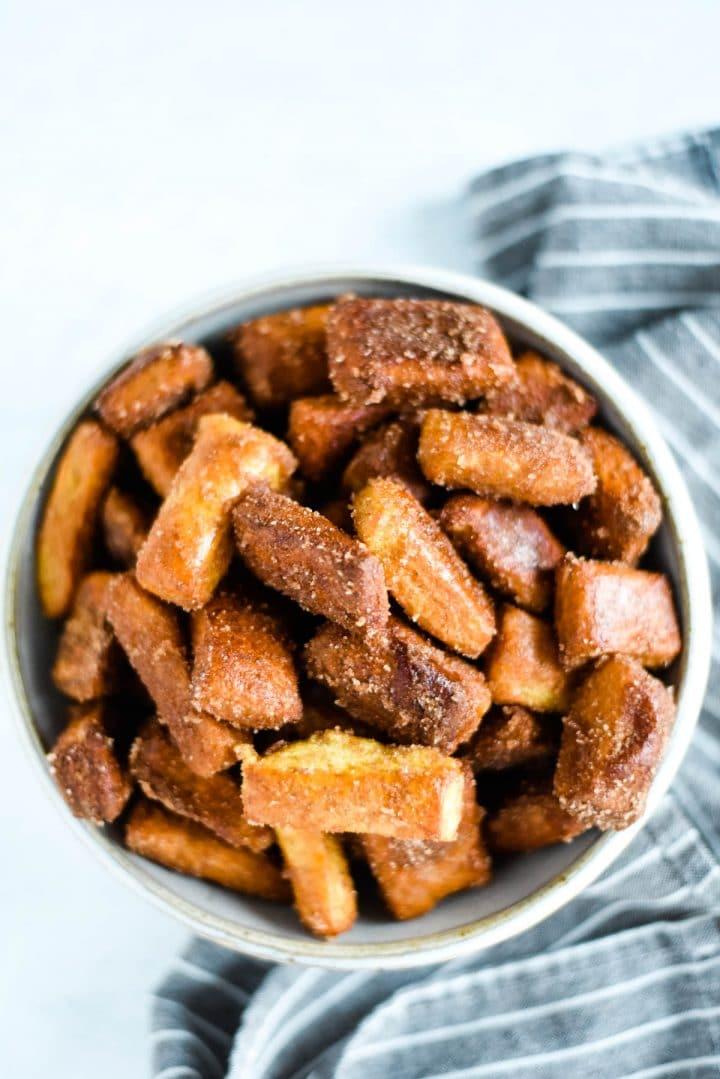 overhead view of cinnamon sugar pretzels in bowl