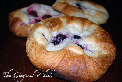close up of sourdough pastry with cream cheese and fruit filling