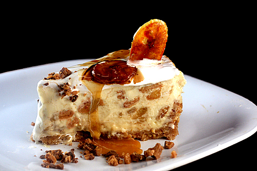 Caramelized Banana Pudding Cheesecake with Salted Cashew Praline - Vanilla Wafer Crust