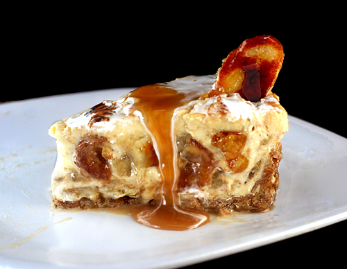 Slice of Caramelized Banana Pudding Cheesecake with a praline-vanilla wafer crust