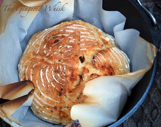 sourdough bread in cast iron skillet with parchment paper