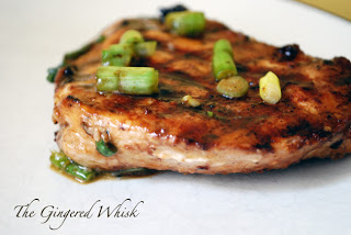 close up of hawaiian bbq chicken with green onions sprinkled on top