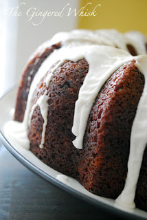 sourdough bundt cake on plate with icing drizzle