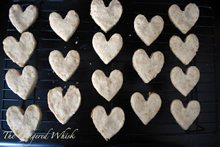 heart shaped shortbread cookies on metal wire cooling rack