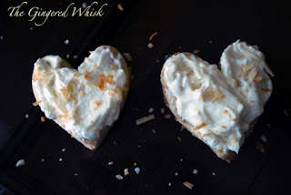 two shortbread cookies with pineapple cream and shredded coconut