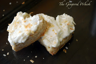 two heart shaped shortbread cookies with pineapple cream