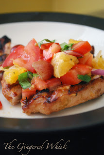 plate with grilled pork chop and fruit salsa