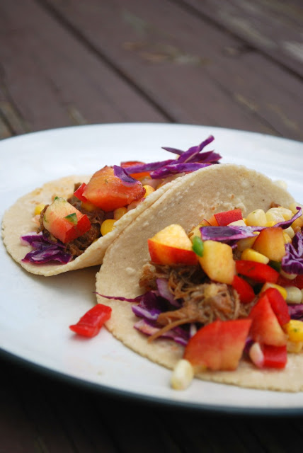 two tacos with pulled pork and nectarine salsa