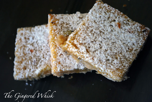 overhead view of three slices of lemon bars with powdered sugar on top