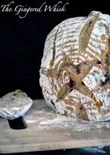 earl grey sourdough loaf standing on cutting board