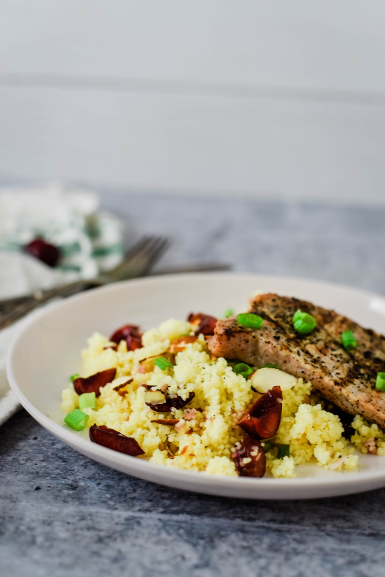 grilled pork chops with couscous on plate
