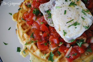 close up image of two cheddar waffles topped with salsa and poached egg