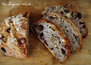 slices of sourdough beside boule, made with strawberries, almonds and camembert