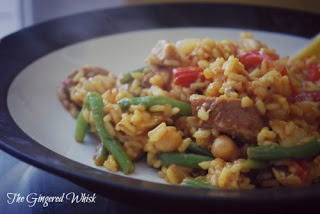 bowl filled with chicken and sausage paella