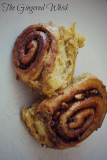 two spiced sweet rolls on plate