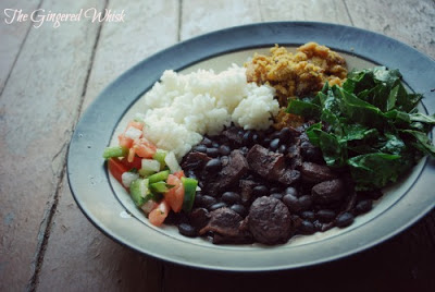 plate of food with feijoada and farofa, rice, and pico de gallo