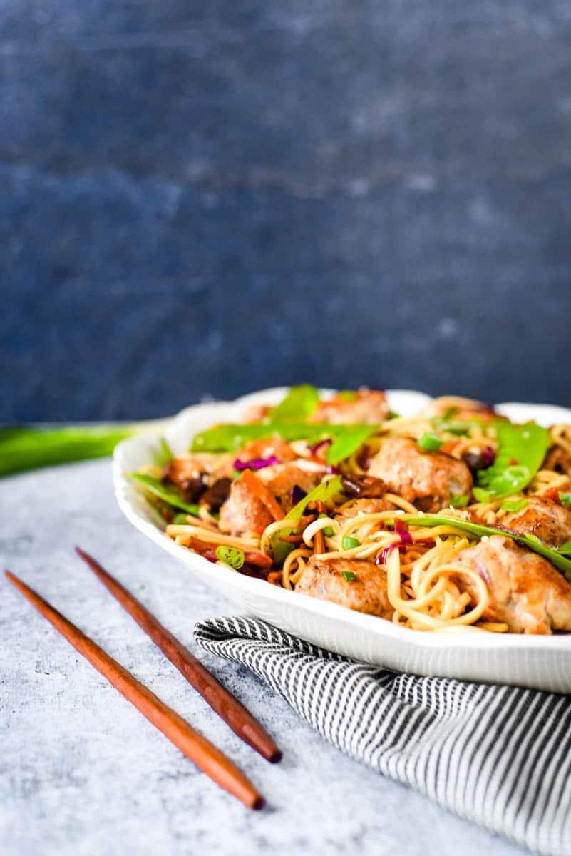 ginger pork meatballs with noodles and vegetables on platter