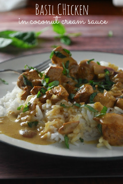 Chicken cooked in coconut cream sauce on a bed of white rice