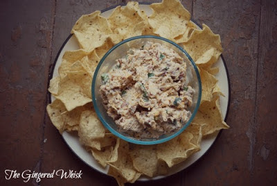 bacon dip in bowl surrounded by chips