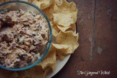 bowl of bacon dip with tortilla chips beside