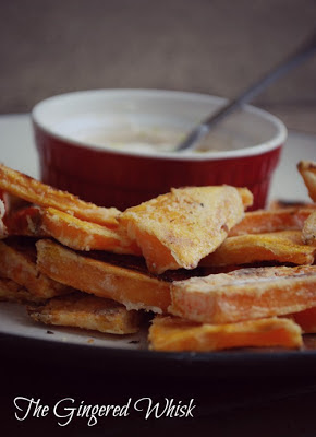 Crispy Sweet Potato Wedges on platter with Spicy Lime Dipping Sauce
