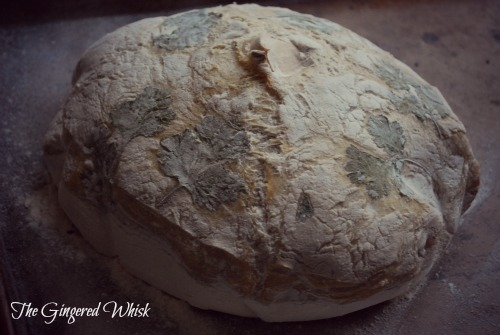 roasted garlic sourdough loaf with parsley on top