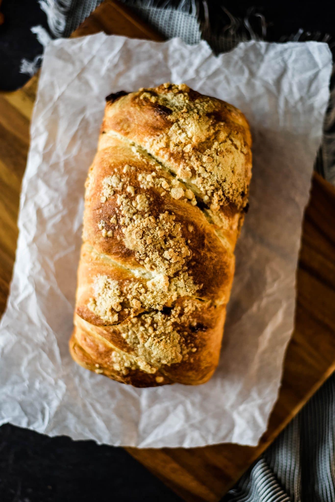 loaf of sourdough babka on parchment paper