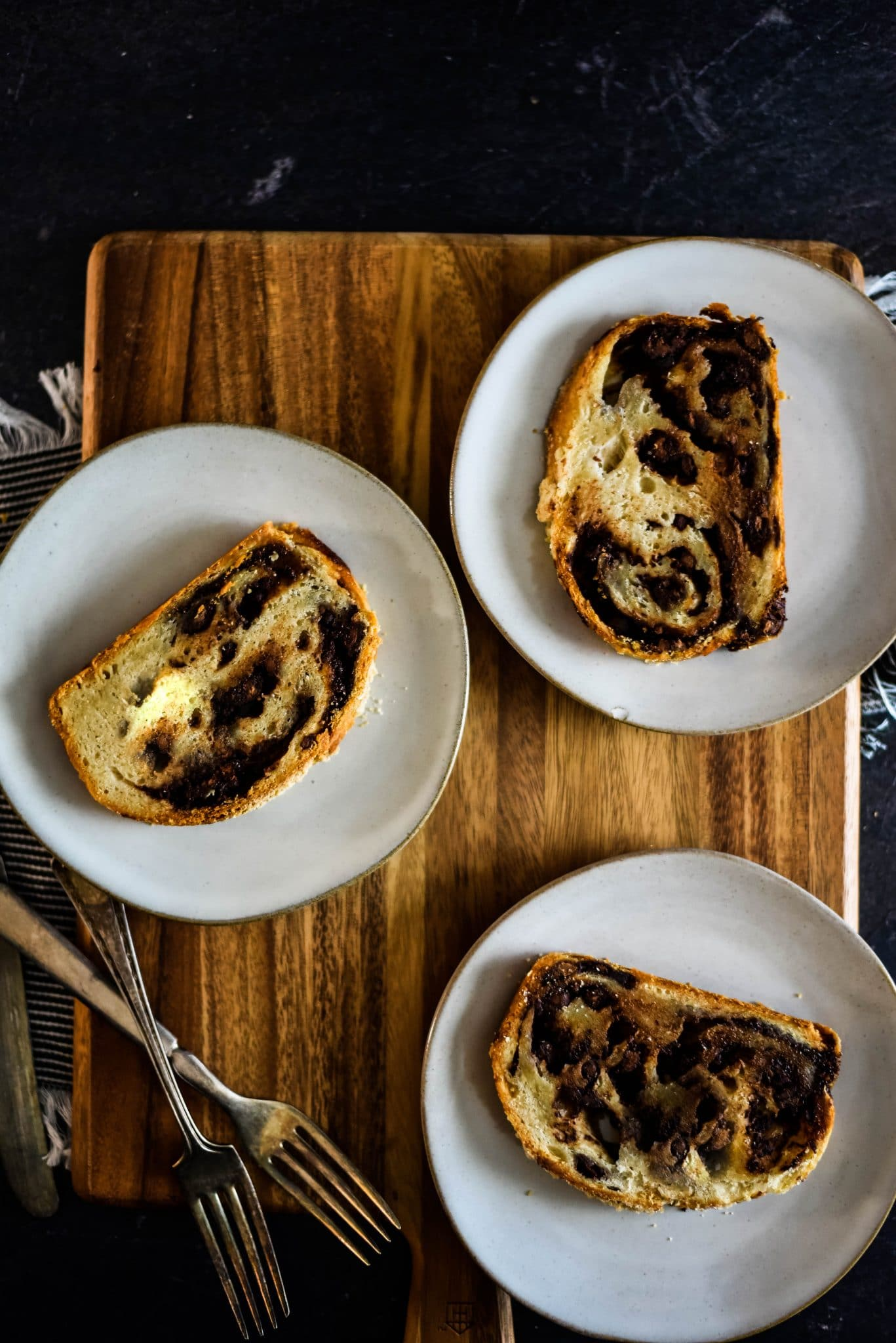 three plates with slices of babka bread on them