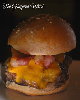 venison burger with bacon and cheddar cheese on a bun