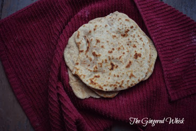 Sourdough Naan flatbread wrapped in red towel