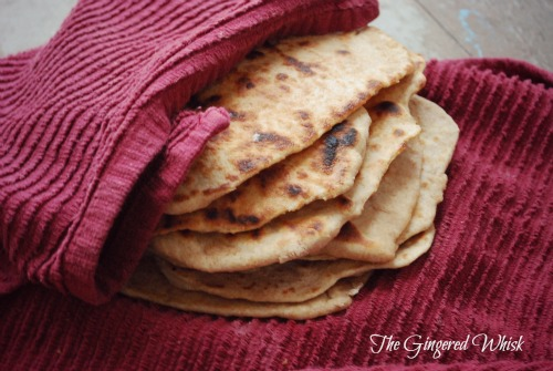 Sourdough Naan flat bread recipe wrapped in a red towel