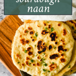 sourdough naan with text overlay of recipe name for pinterest