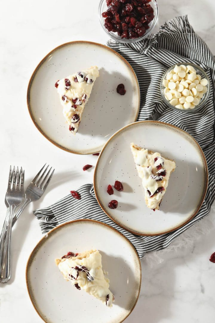 sourdough blondies on three plates with forks beside