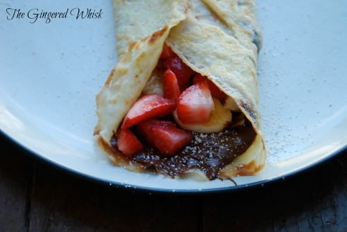 Sourdough Crepe with nutella and strawberries on white plate