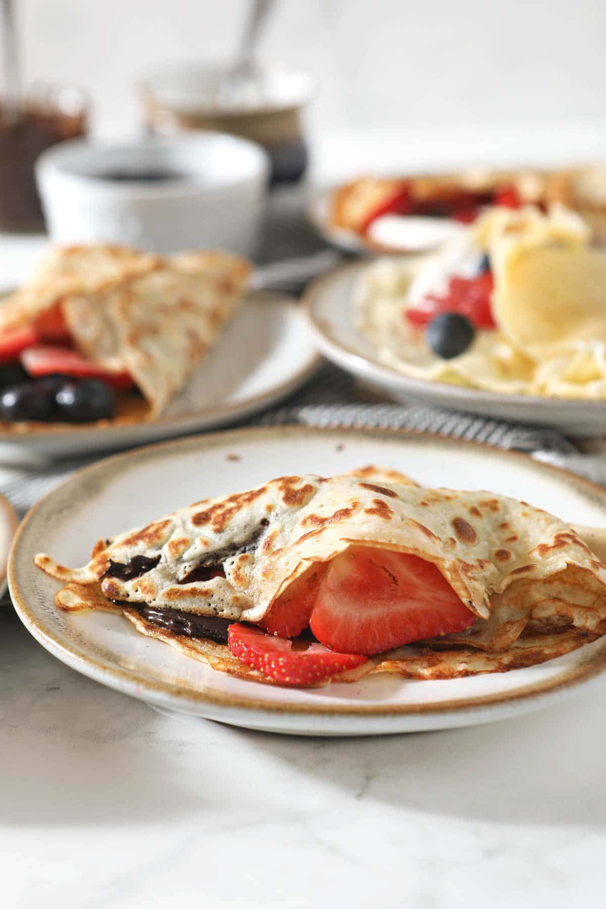 sourdough crepes with berries on plate