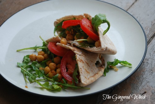 Fried Chickpea and Arugula Pitas with Lime Tzatziki on white plate