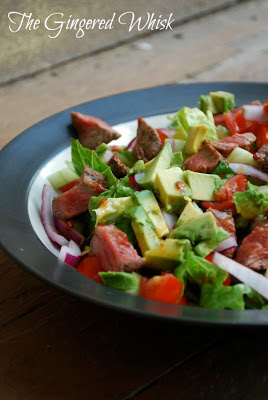 salad with steak and avocado on plate
