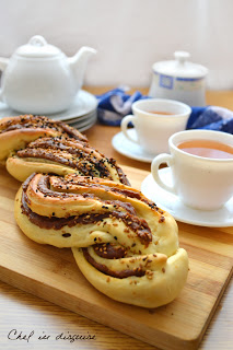 braided date bread on table with tea