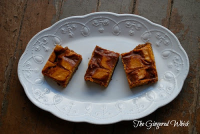 Pumpkin Cheesecake Bars with Salted Caramel Swirls on white decorative platter