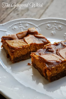 two Pumpkin Cheesecake Bars with Salted Caramel Swirls on white platter